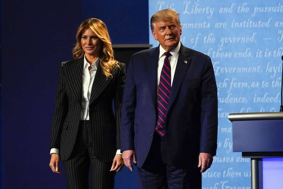 President Donald Trump stands on stage with first lady Melania Trump after the first presidential debate with Democratic presidential candidate former Vice President Joe Biden Tuesday, Sept. 29, 2020, at Case Western University and Cleveland Clinic, in Cleveland, Ohio. (AP Photo/Julio Cortez) Photo: Julio Cortez/AP / Copyright 2020 The Associated Press. All rights reserved.
