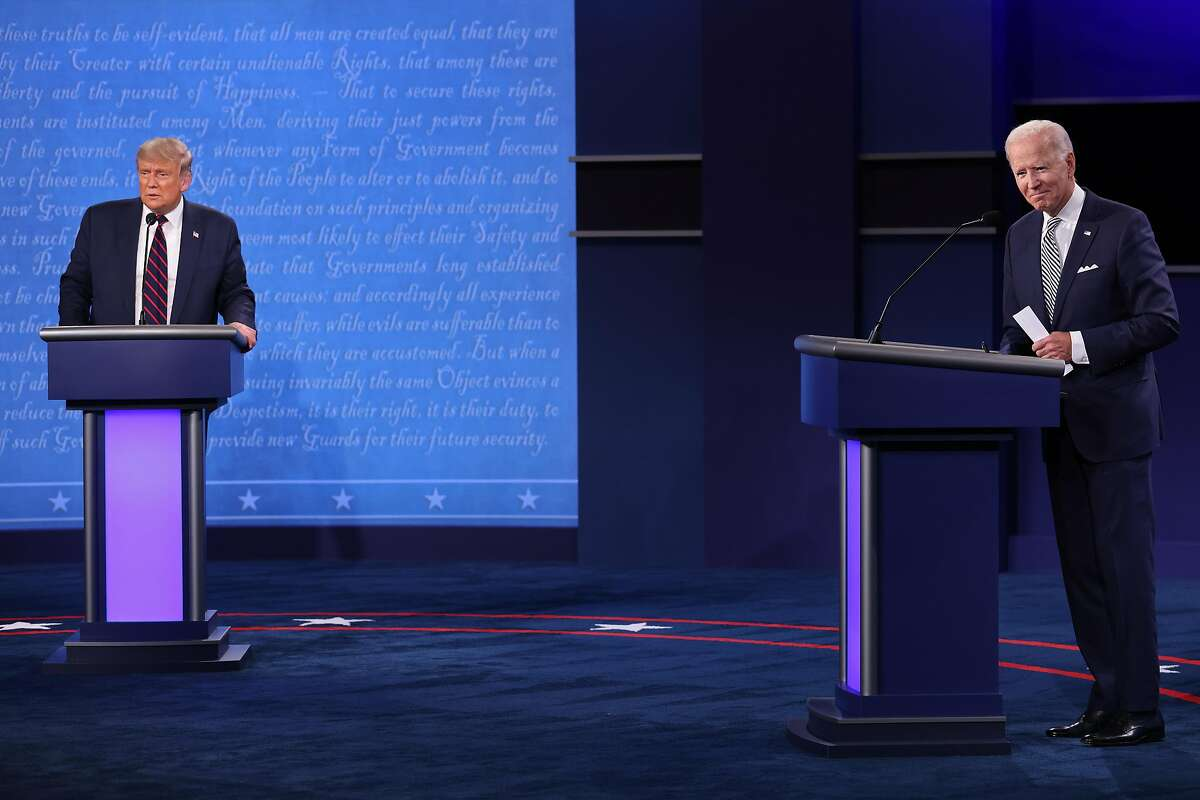 U.S. President Donald Trump and Democratic presidential nominee Joe Biden look out to the small in-person audience at the end of the first presidential debate at the Health Education Campus of Case Western Reserve University on Sept. 29, 2020, in Cleveland, Ohio.