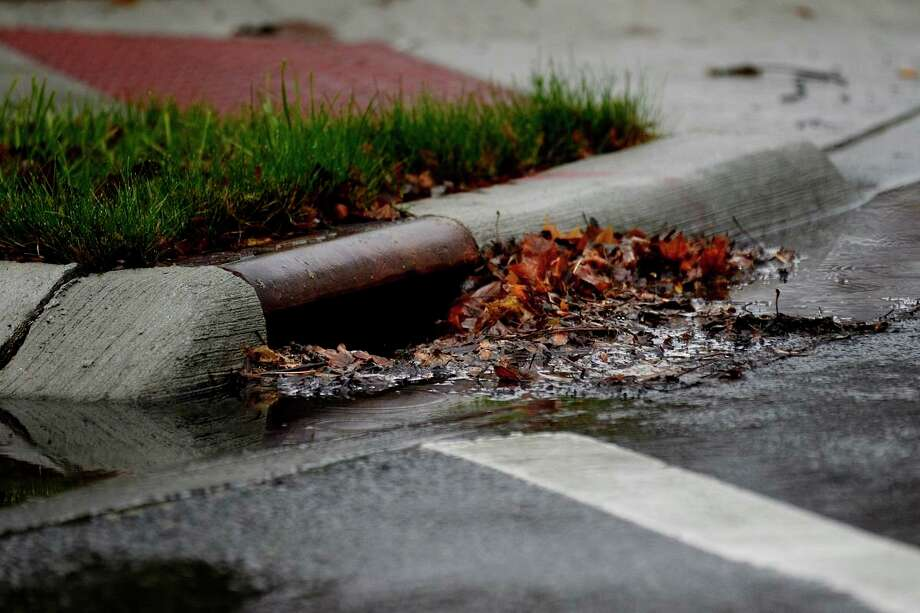 Residents are being asked to periodically check and clear the street drains near their homes to ensure proper water drainage at all times. (file photo)