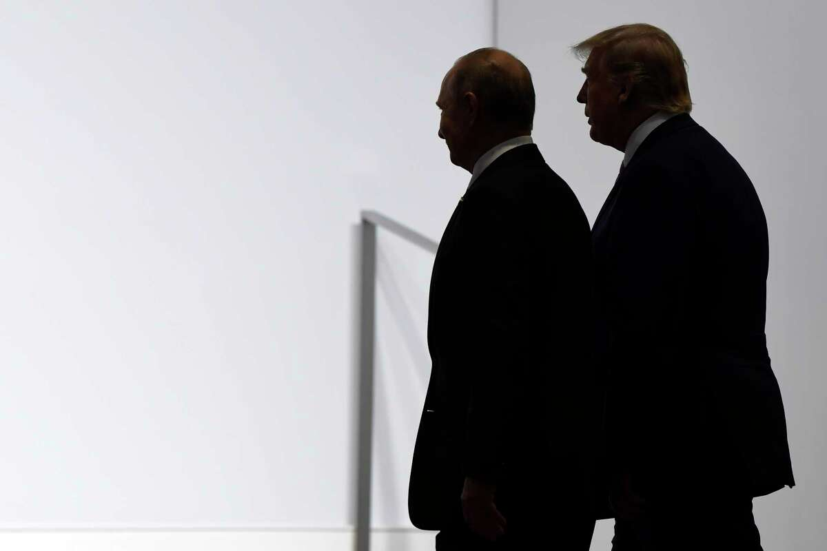 In this June 28, 2019, file photo President Donald Trump and Russian President Vladimir Putin walk to participate in a group photo at the G20 summit in Osaka, Japan.