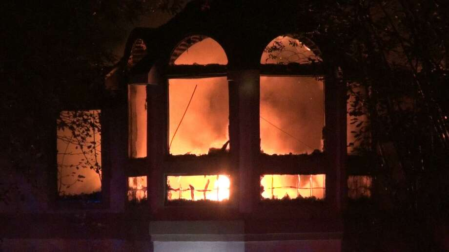 The inside of a house off Lake Conroe in Willis is seen on fire early Friday, Oct. 2, 2020. A woman's remains were found inside. Photo: Courtesy Of The Montgomery County Police Reporter