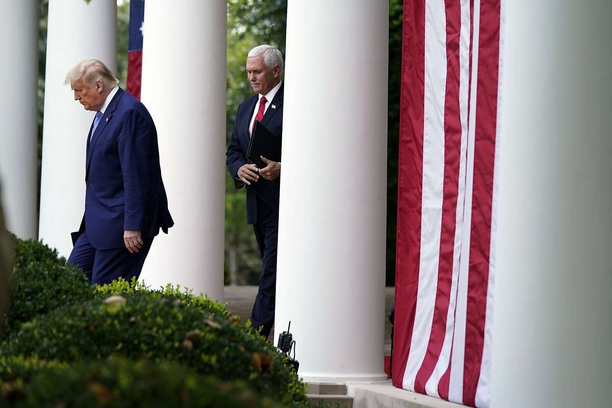 President Donald Trump arrives with Vice President Mike Pence to speak about coronavirus testing during an event in the Rose Garden of the White House on Sept. 28.