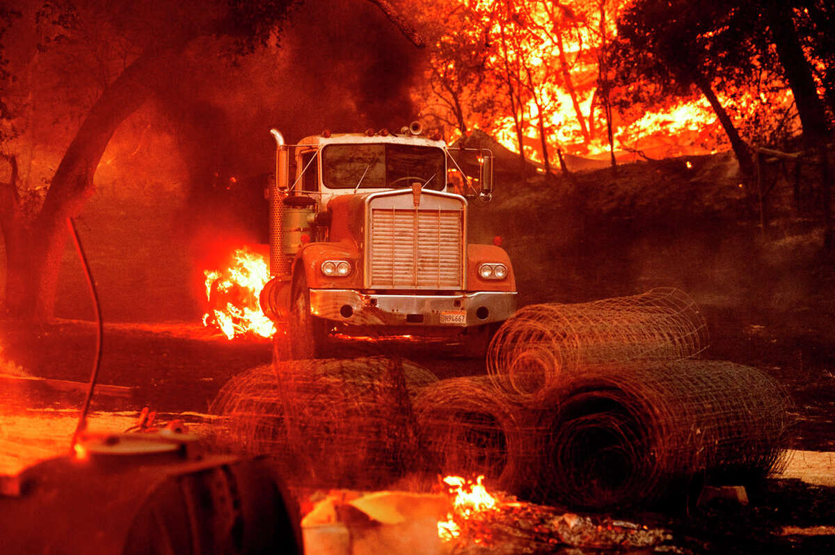 Flames from the Glass Fire burn a truck in a Calistoga, Calif., vineyard Thursday, Oct. 1, 2020.