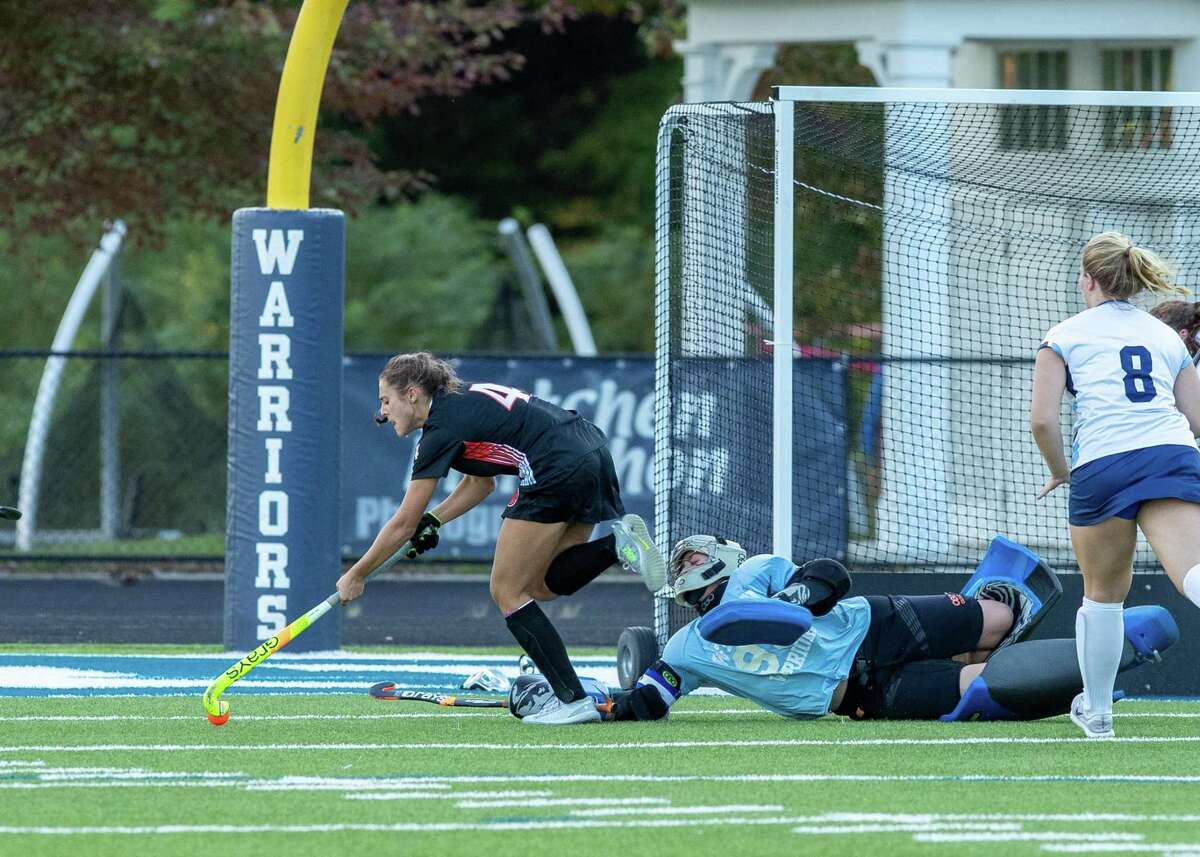 Aerin Krys gets ready to score one of her three goals in the Ridgefield field hockey team's 5-1 win over Wilton on Thursday.