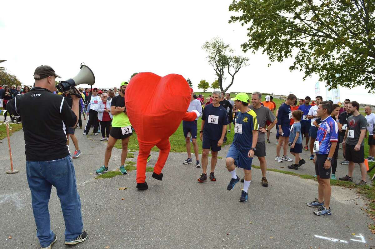 The American Heart Association mascot helps keep it light before the 5K at the 26th annual Fairfield County Heart Walk in 2016 in Westport.