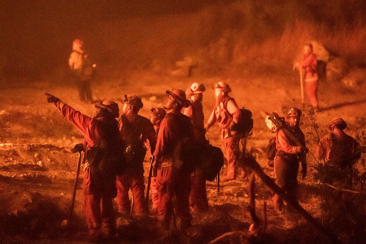 An inmate fire crew monitors a controlled burn to fight the Glass Fire on Highway 29 near Calistoga.
