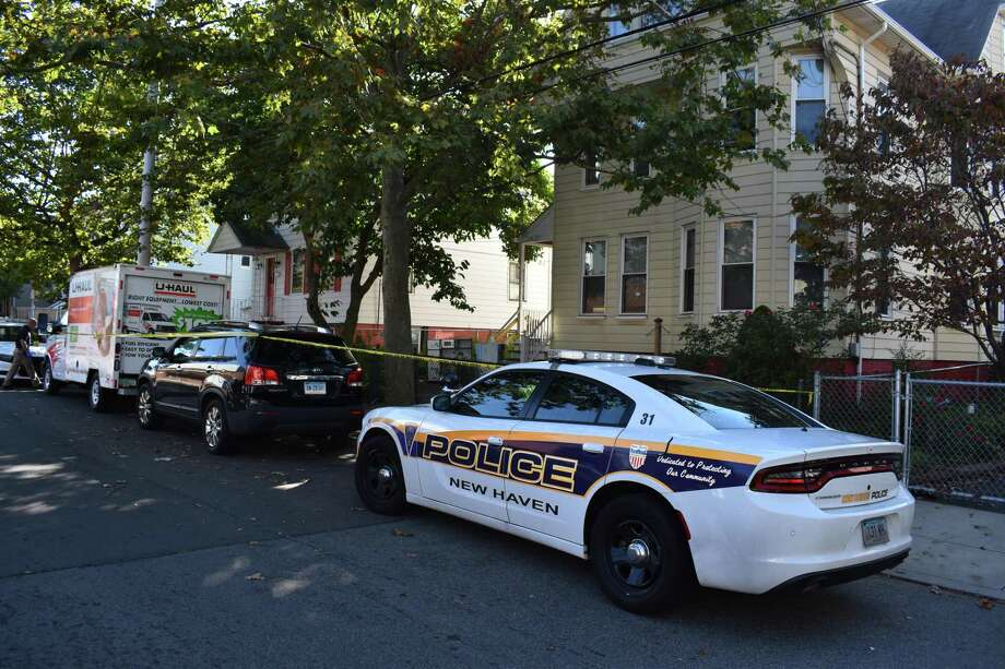 New Haven police investigated a homicide on Exchange Street Thursday morning. Photo: Ben Lambert / Hearst Connecticut Media