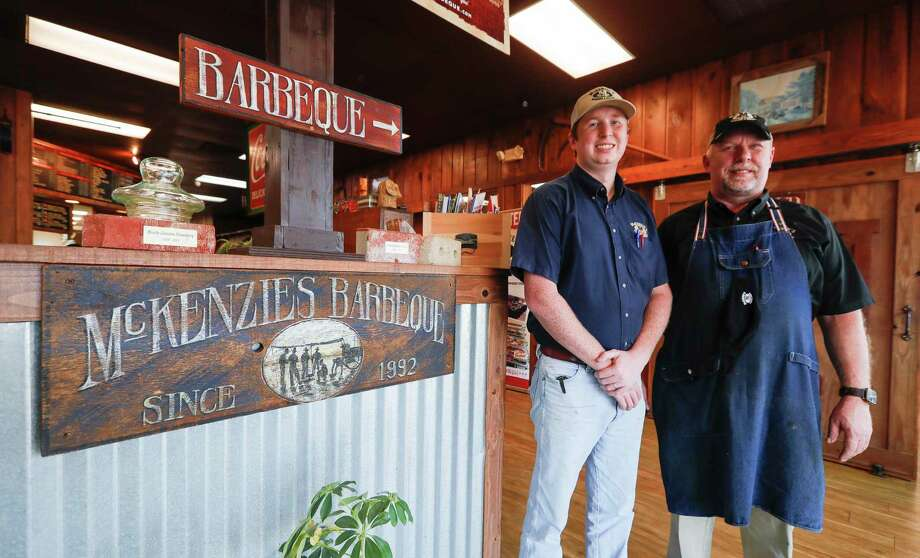 Colin McKenzie, left, pose for a portrait with his dad, Darin, at Mckenzie's Barbeque and Burgers, Thursday, Oct. 1, 2020, in Conroe. Photo: Jason Fochtman, Houston Chronicle / Staff Photographer / 2020 © Houston Chronicle
