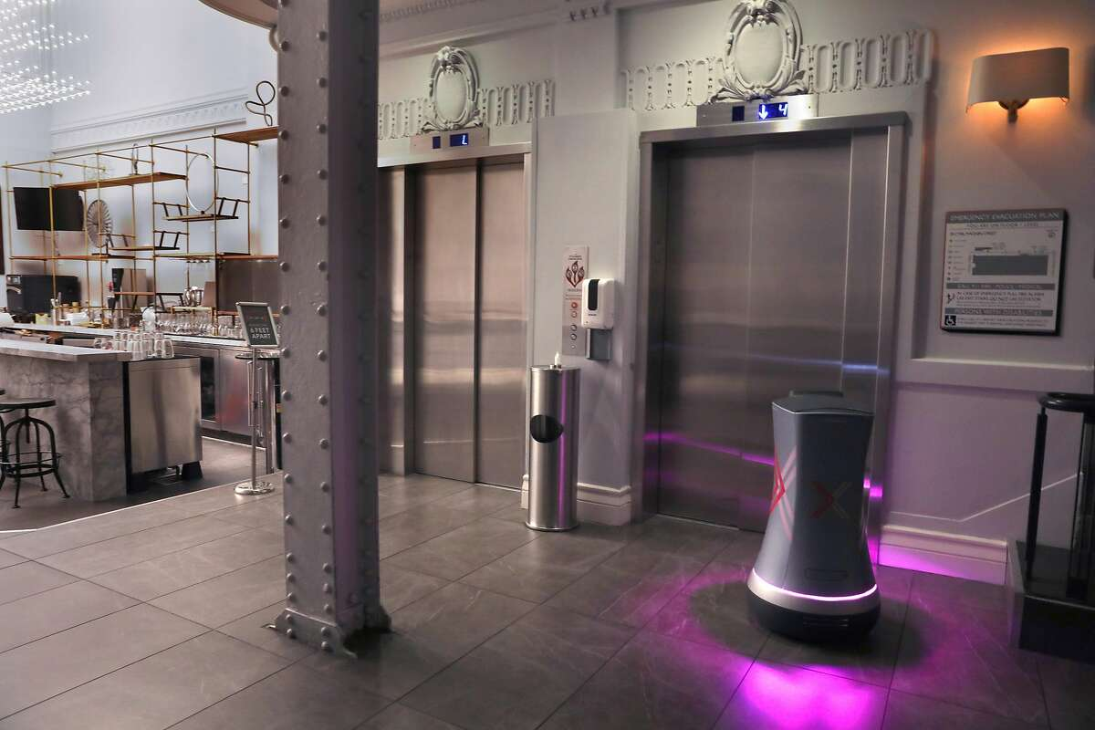 Axiom Hotelnear Union Square has been using a room service drone by Savioke seen waiting for the elevator on Thursday, Oct. 1, 2020, in San Francisco, Calif. More hotels are using these robots during the pandemic to aid the 'touchless' environment hotels.