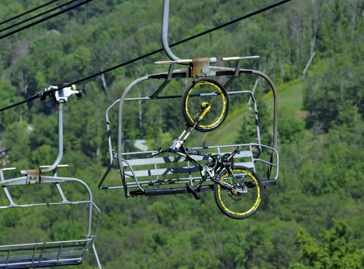 A racer's bike rides the lift up the mountain Sunday during the Windham 2010 Mountain Bike World Cup Festival to get to the starting line of the men's downhill final. (Philip Kamrass / Times Union)