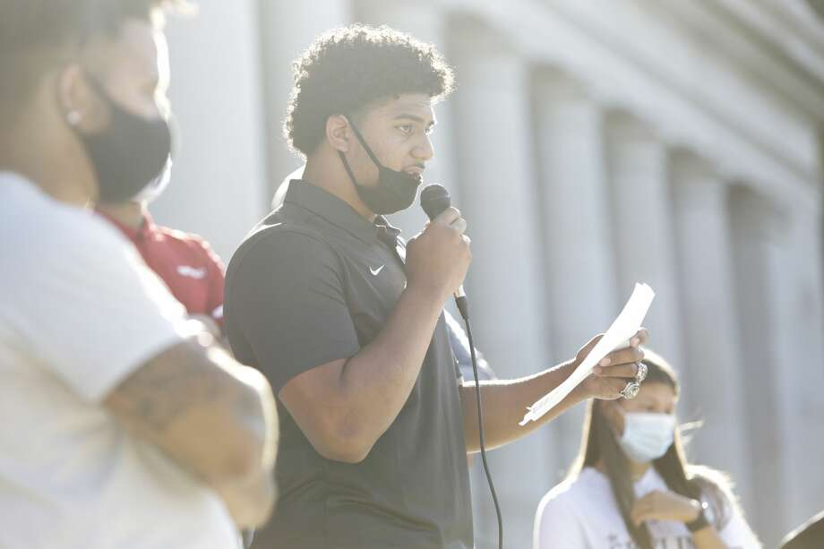 Eastside Catholic High School football player J.T. Tuimoloau, one of the top recruits in the US, speaks during a rally at the state capitol organized by Student Athletes of Washington (SAW), a group that formed to protest the postponement of fall sports due to COVID-19, in Olympia, Washington on September 3, 2020. (Photo by Jason Redmond / AFP) (Photo by JASON REDMOND/AFP via Getty Images) Photo: JASON REDMOND/AFP Via Getty Images