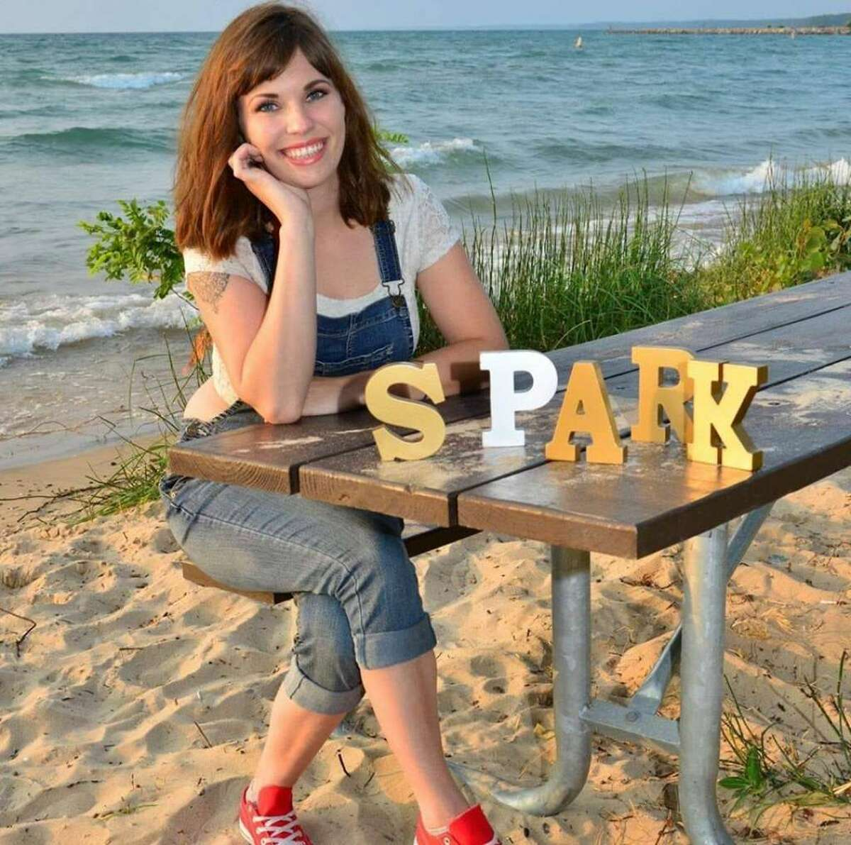 Abagail McKiernan, founder of Traverse City nonprofit Spark in the Dark, has extended her organization's reach into Manistee and Mt. Pleasant.