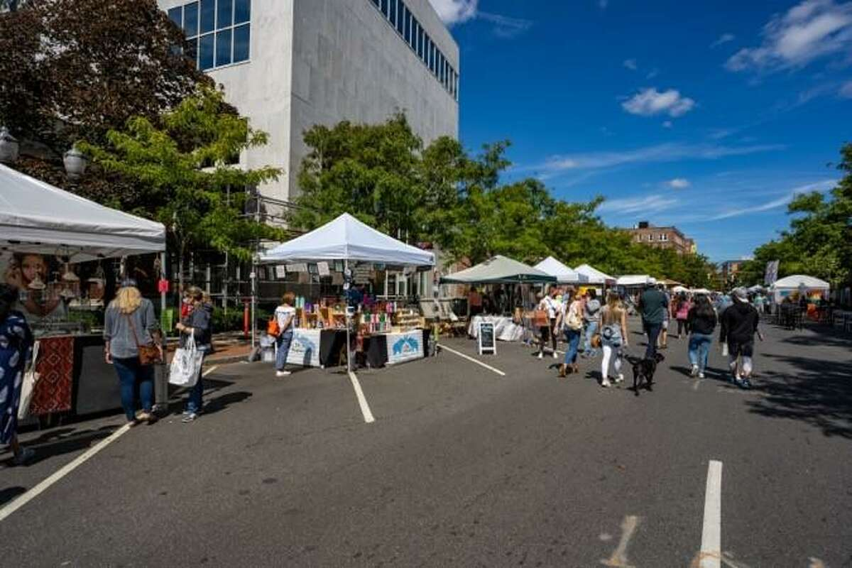 Stamford Downtown is hosting its second Arts & Crafts show on Bedford Street this year on Oct. 17. Pictured are visitors to the Sept. 12 event.