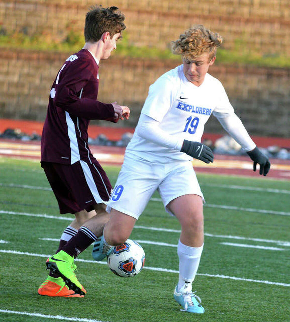 Marquette Catholic's Matt Lehr (right) battles a Chicago U-High player for the ball during the 2019 Class 1A boys soccer state championship match last fall. Under the IHSA's adjusted schedule because of the virus panemic, boys soccer will be played in next spring instead of fall.