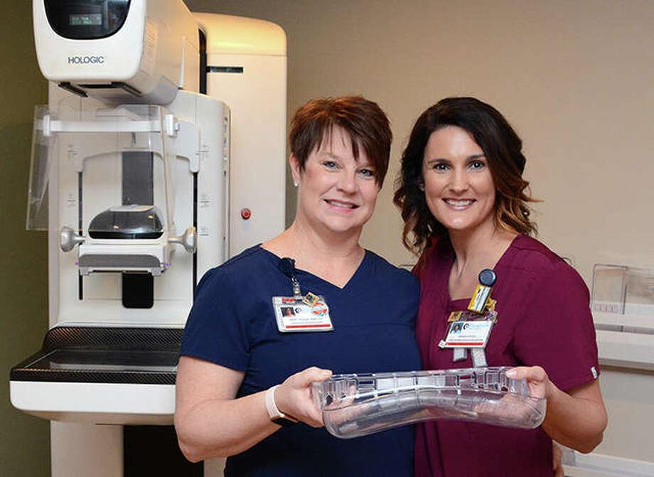 Becky McClellan (left) and Amanda Vortman, mammography technicians at Passavant Area Hospital, show the Smart Curve paddle. Photo: Photo Provided