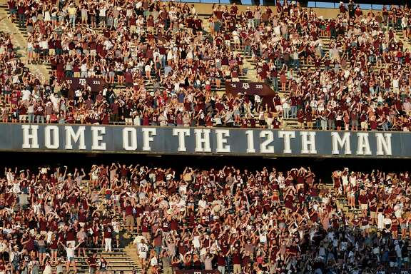 Texas A&M fans cheer as the team takes the field for an NCAA college football game against Vanderbilt Saturday, Sept. 26, 2020, in College Station, Texas. (AP Photo/David J. Phillip)