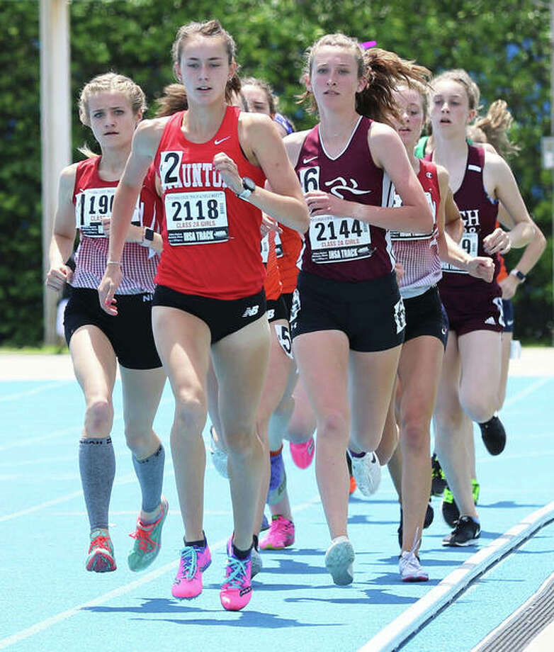 Staunton's Lydia Roller leads a pack of runners early in the 3,200-meters at the 2019 Class 2A girls track state meet at Eastern Illinois University in Charleston. Roller finished fourth in this race and second in the 1,600 as a sophomore. Her junior season was wiped out by COVID-19 concerns, but Roller had reason to celebrate Friday with her commitment to run college track and cross country for the Missouri Tigers. Photo: Greg Shashack | The Telegraph