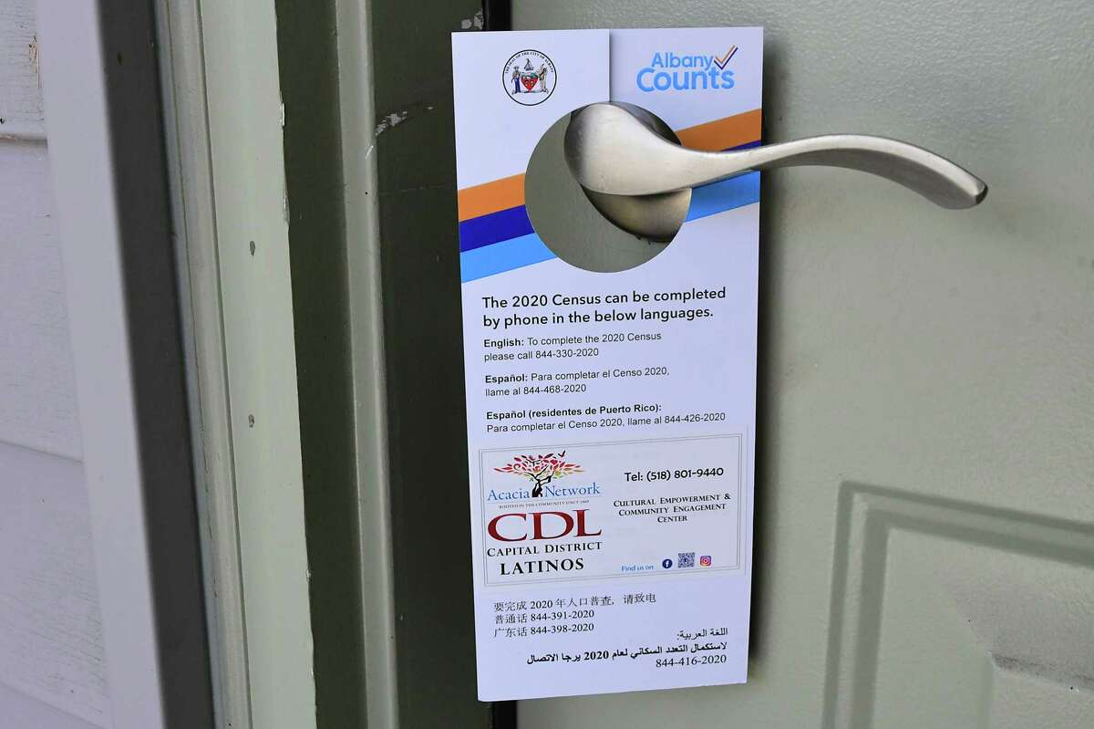 A census information card is left on a door handle by census outreach workers from Capital District Latinos in Arbor Hill on Wednesday, Sept. 30, 2020 in Albany, N.Y. (Lori Van Buren/Times Union)