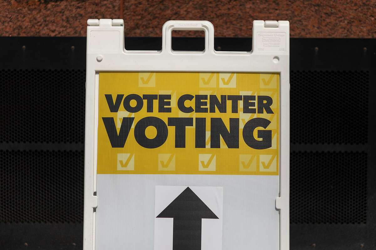 ANAHEIM, CA - SEPTEMBER 16: Signage is seen during a press preview of a voting center to be used during the 2020 presidential election at the Honda Center sports arena on September 16, 2020 in Anaheim, California. The vote center includes both drive-thru and walk-in voting. (Photo by David McNew/Getty Images)