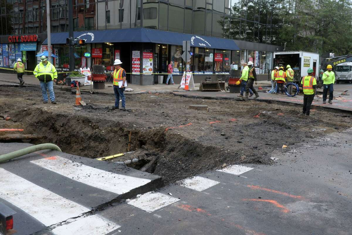 Works crews remained on the scene Friday morning following a water main break that closed the intersection of Main St. and Fairfield Ave., in Bridgeport, Conn. Oct. 1, 2020. The break occurred Thursday evening, and flooded surrounding streets in downtown.