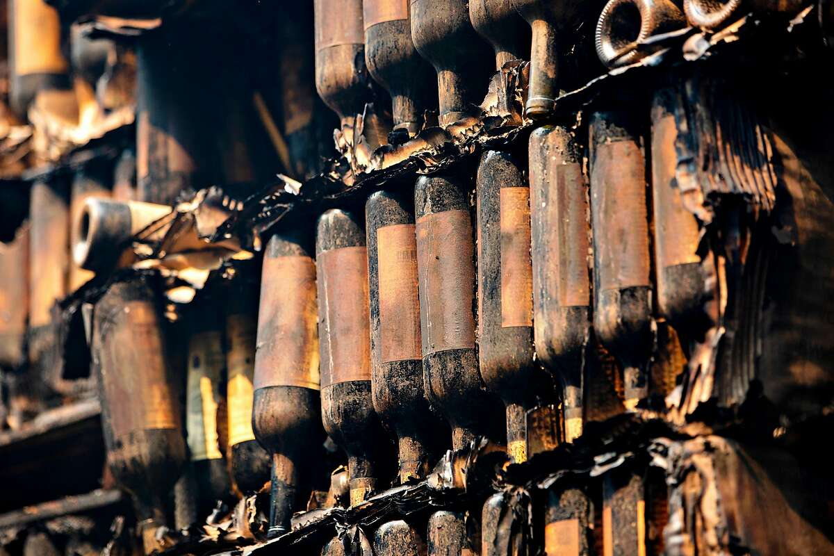 Wildfires destroyed many wineries' wine inventory in 2020, including these bottles at Napa Valley's Castello di Amorosa.