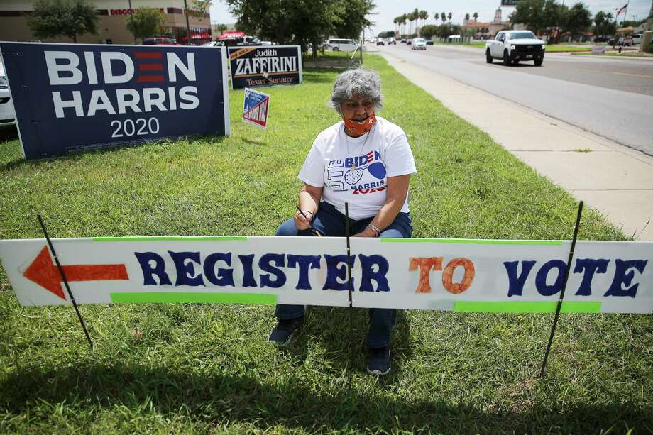 Dora Gonzalez takes a pause in touching up a sign to encourage people to register to vote at the Webb County Democratic Party headquarters in Laredo on Wednesday, Sept. 23, 2020. Photo: Kin Man Hui, San Antonio Express-News / Staff Photographer / **MANDATORY CREDIT FOR PHOTOGRAPHER AND SAN ANTONIO EXPRESS-NEWS/NO SALES/MAGS OUT/ TV OUT