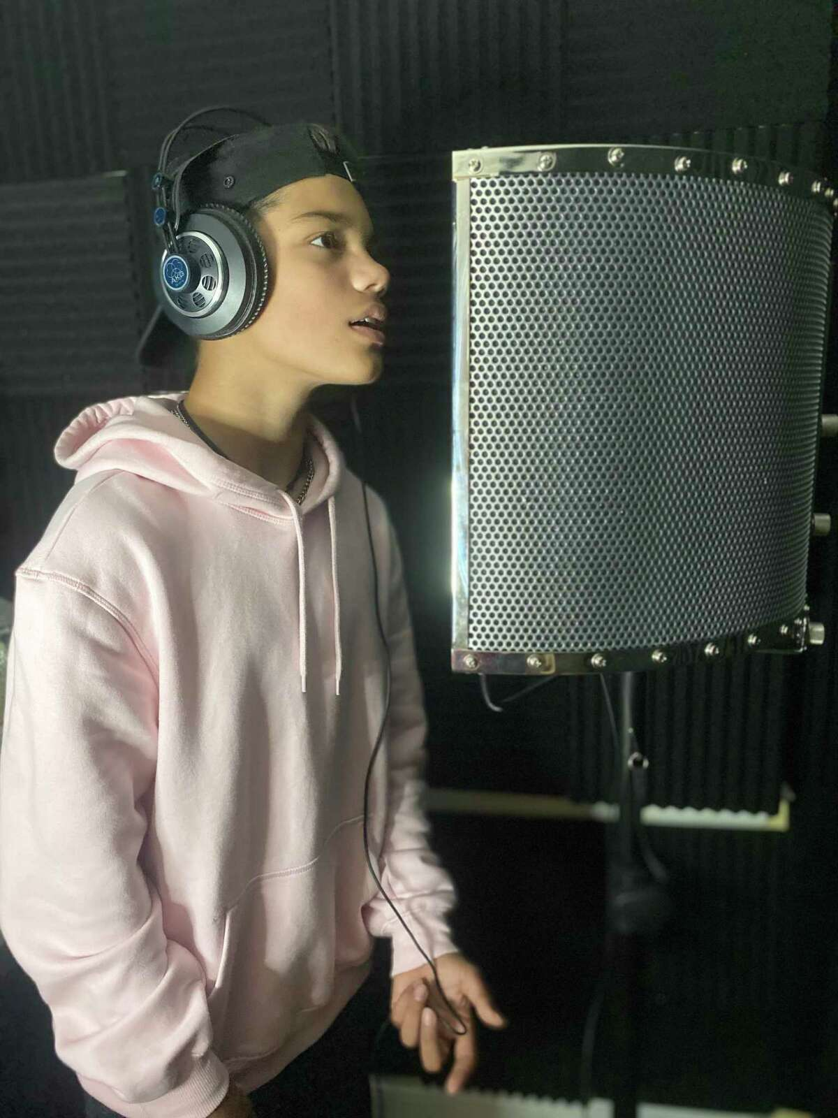 """Bridgeport resident Kevin Chacon, 13, seen here in his home studio, voices Santiago Montes, a brave and kindhearted pirate who sets sail on amazing adventures in Nickelodeon's new animated preschool series, """"Santiago of the Seas."""" The series debuts Oct. 9."""