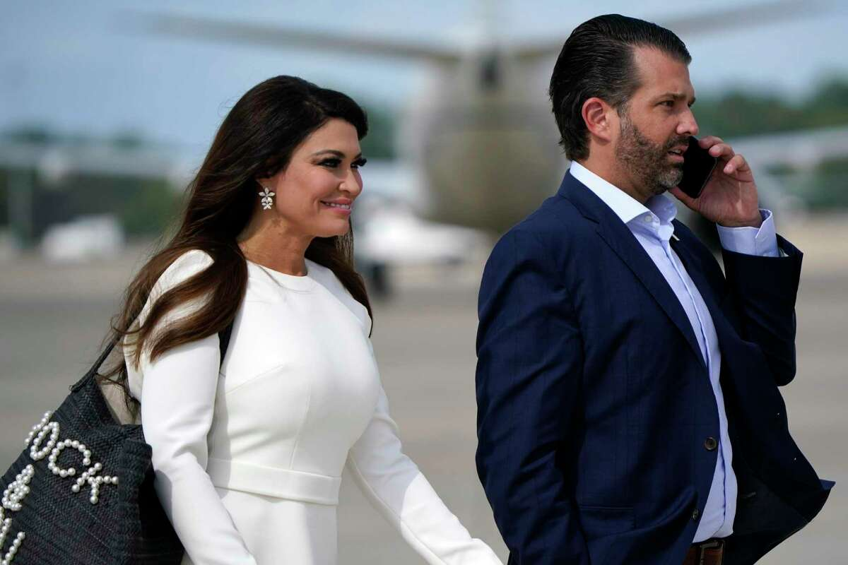 Donald Trump Jr. and Kimberly Guilfoyle walk across the tarmac to board Air Force One at Andrews Air Force Base before flying to Cleveland, Ohio, for the first presidential debate Tuesday, Sept. 29, 2020. (AP Photo/J. Scott Applewhite)