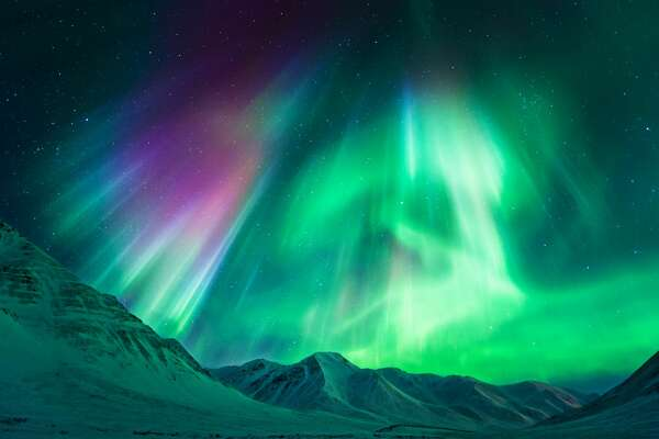 Stong geomagnetic Aurora Borealis (Northern Lights) above Alaskan mountains, Atigun Pass - Dalton highway (North of Fairbanks), Alaska, USA.