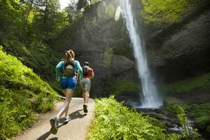 Several people trail running in Oregon's Columbia Gorge.