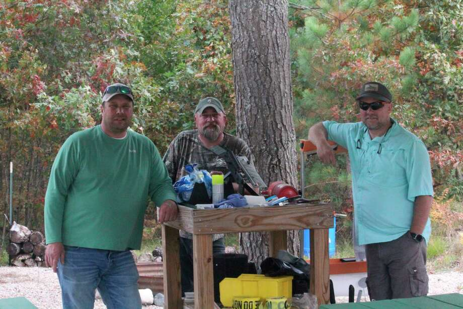Lake County Sportsman Club members getting ready for last Saturday's open house are, from left, Harold Nichols, Dan Tagliareni and Greg Nichols. (Pioneer sports photo)