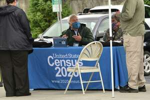 People working for the Census Bureau hold an event outside Honest Weight Food Co-op to get people to complete their 2020 Census forms on Friday, Oct. 2, 2020 in Albany, N.Y. (Lori Van Buren/Times Union)