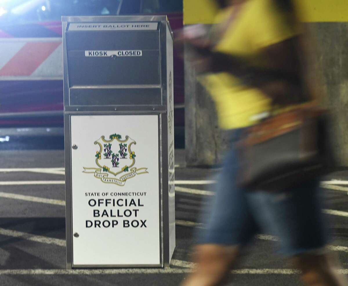 A Connecticut absentee ballot drop box is located outside the Government Center in Stamford, Conn. Tuesday, July 21, 2020. Secure metal bins have been placed in towns throughout the state for residents to place their absentee ballot applications and absentee ballots for the upcoming primary election on Aug. 11.
