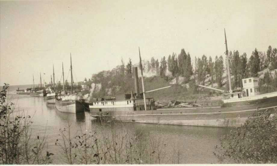 Ships line the Manistee River Channel in this 1890s photograph waiting to take loads of lumber to ports of call around the Great Lakes. (Manistee County Historical Museum photo)