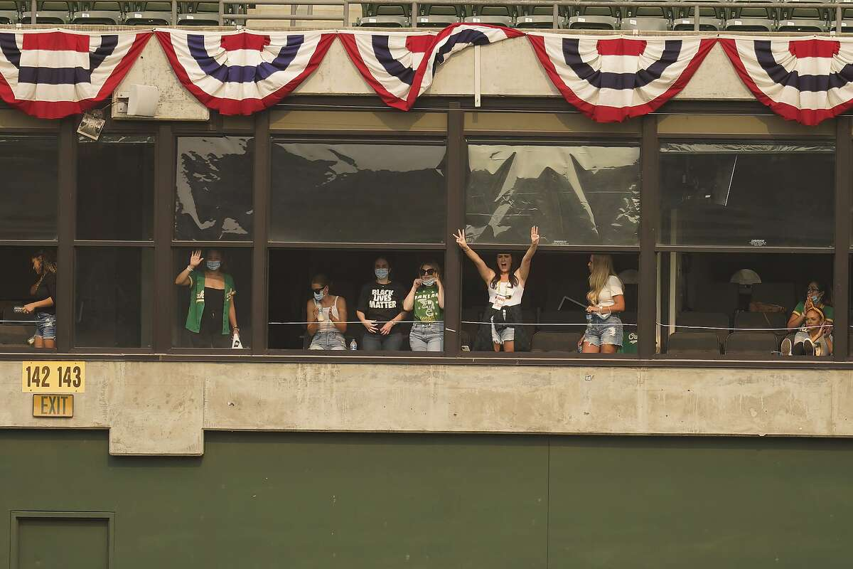 Wives and girlfriends of Oakland Athletics players cheer during Game 3 of an American League wild-card baseball series between the Athletics and the Chicago White Sox Thursday, Oct. 1, 2020, in Oakland, Calif. (AP Photo/Eric Risberg) Left to right: Michelle Kemp, Hannah Maserjian, Kristi Hendriks, Jenna McFarland, Amanda Diekman, Amanda Sedley.