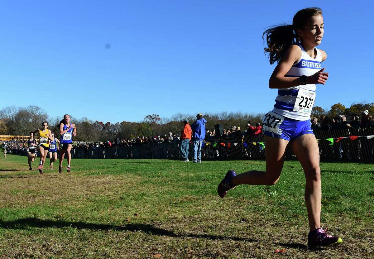 Manchester, Connecticut -Wednesday, November 1, 2019: The CIAC Girls Cross Country Open Championship Friday at Wickham Park in Manchester: 19th place finisher Emily Brydges of Suffield H.S., right.