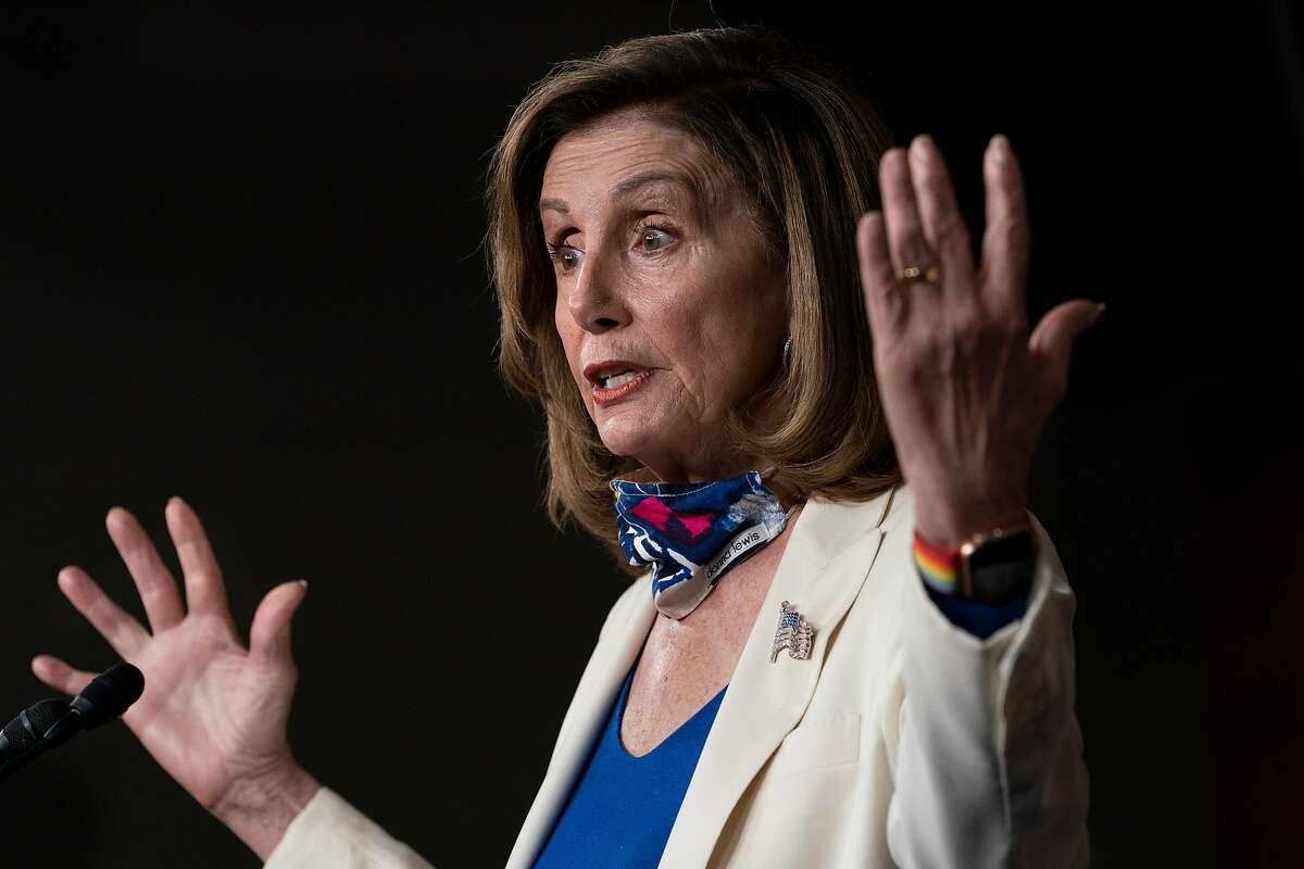 House Speaker Nancy Pelosi seen here in an October 2020 picture, had her San Francisco home spray-painted by vandals early New Year's Day.