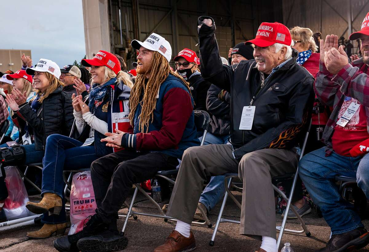 Supporters of President Trump listen to speakers during a rally in Duluth, Minn., on Sept. 30.