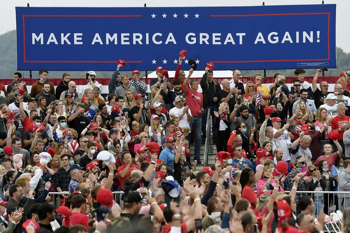 Supporters of President Trump cheer as they wait for a Trump campaign rally to begin Sept. 26 in Middletown, Pa.