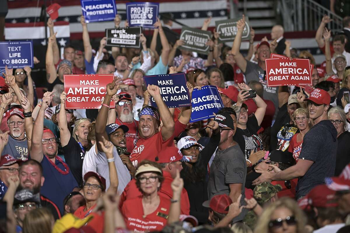 Supporters cheer for President Donald Trump at his campaign rally, Thursday, Sept. 24, 2020, in Jacksonville, Fla.