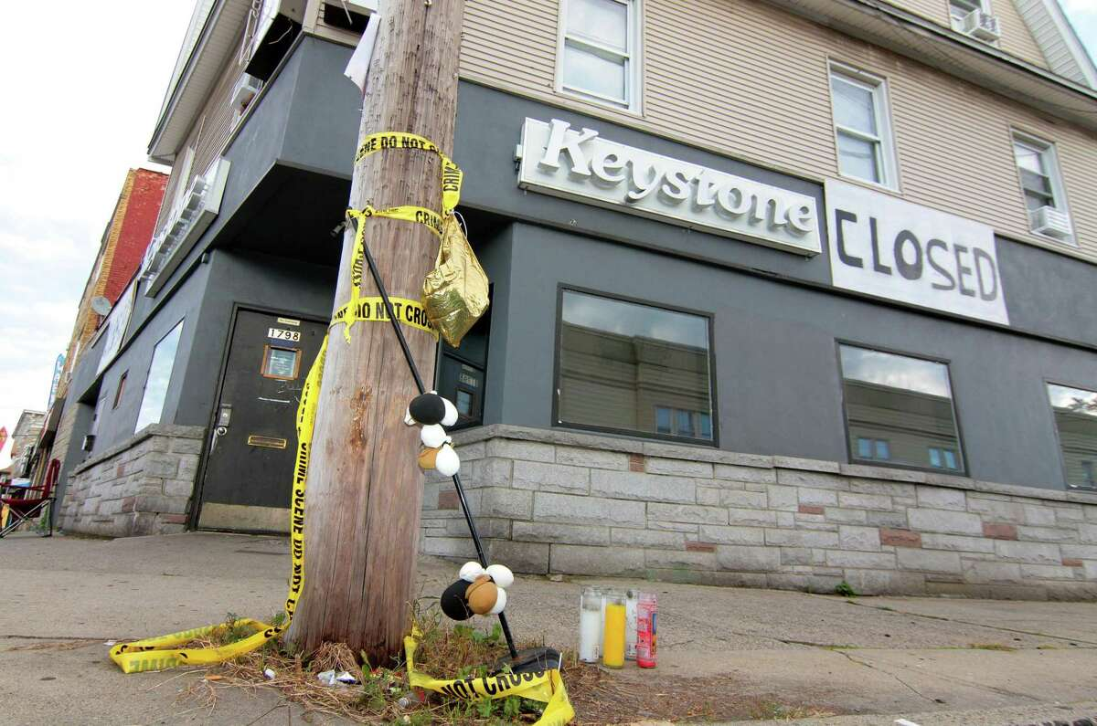 Some 60 people gather to protest in front of the now-shuttered Keystone social club on Barnum Avenue in Bridgeport, Conn., on Thursday Oct. 1, 2020. They demanded the FBI take over the investigation and look into the actions of Bridgeport City Council Member Eneida Martinez, who managed the club.