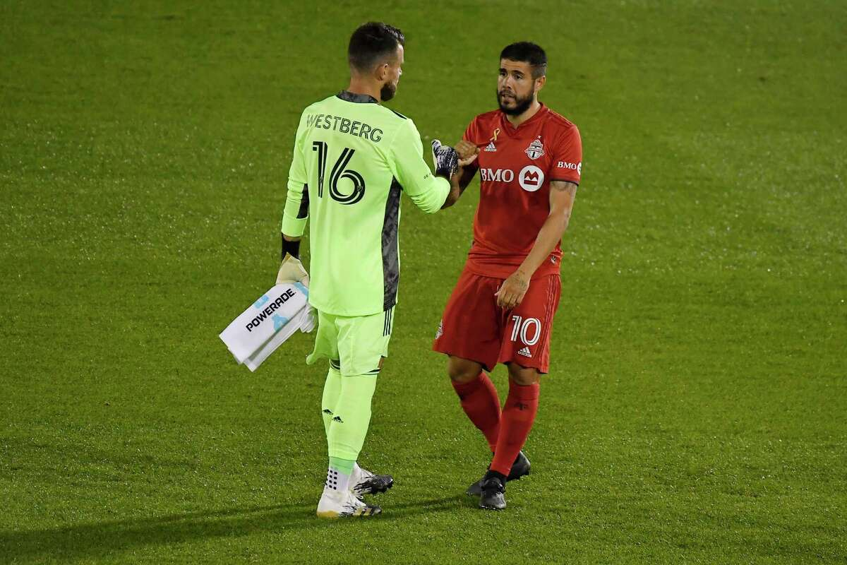 Toronto FC goalkeeper Quentin Westberg, left, bumps arms with Toronto FC's Alejandro Pozuelo before a game against Columbus at Rentschler Field. Westberg and Pozuelo, the MLS leader with eight assists, figure to play key roles in Saturday's showdown against Philadelphia.