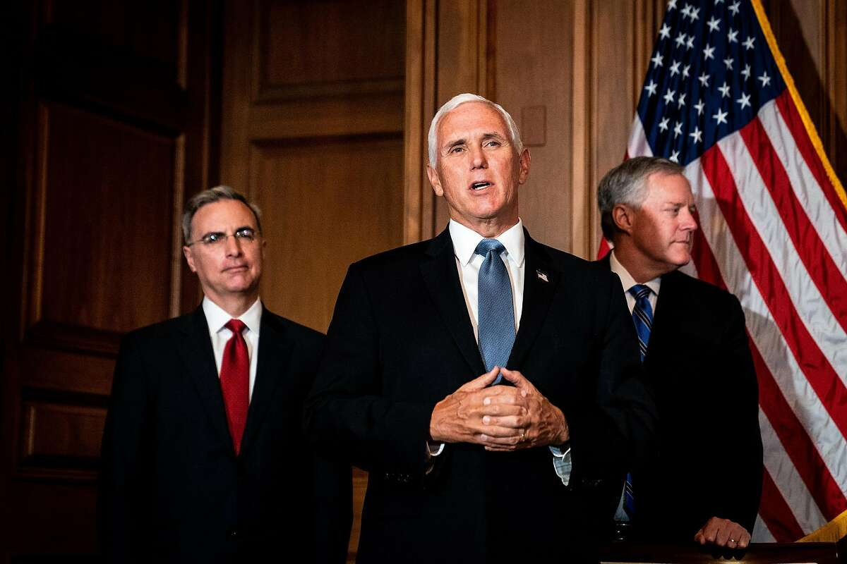 Vice President Mike Pence speaks at the White House flanked by , White House Chief of Staff Mark Meadows and White House Counsel Pat Cipollone.