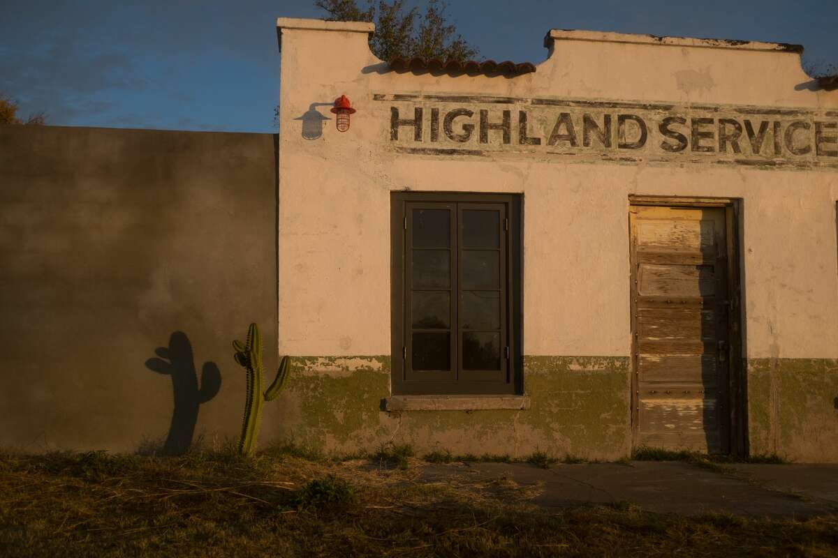 A cactus casts a shadow in the early morning sun against the wall of a building in the town of Marfa, West Texas.