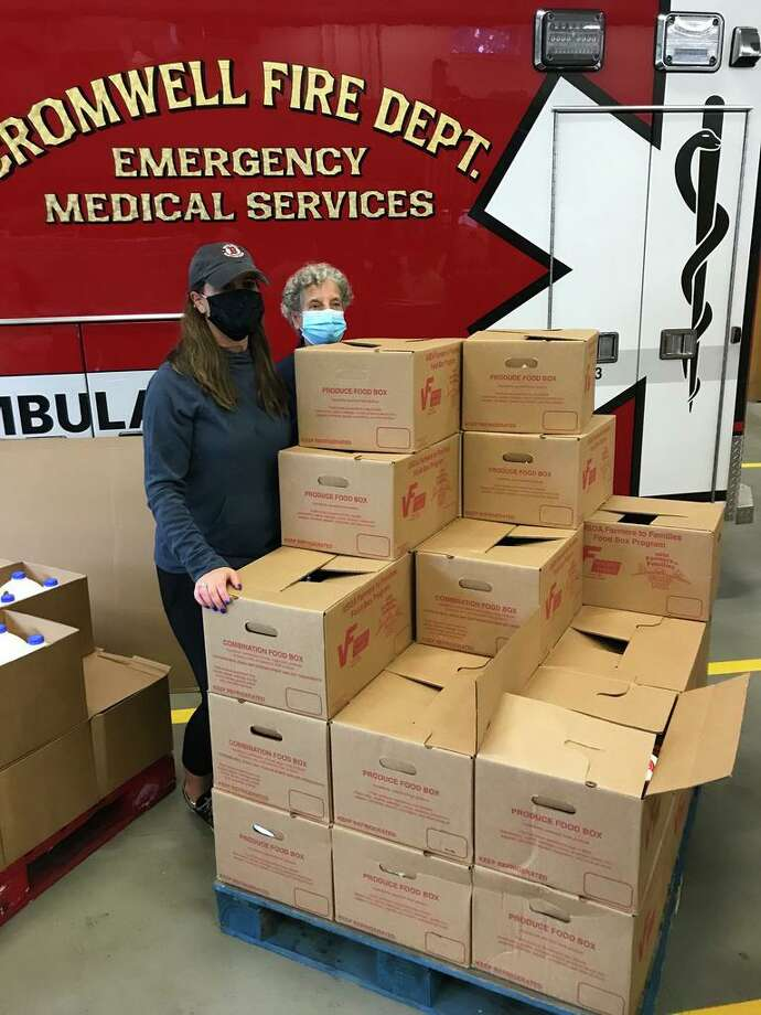 A cooperative effort involving a Delaware farmer and a cadre of local volunteers and the U.S. Department of Agriculture has provided boxes of fresh food to more than 1,100 families. Photo: Jeff Mill /