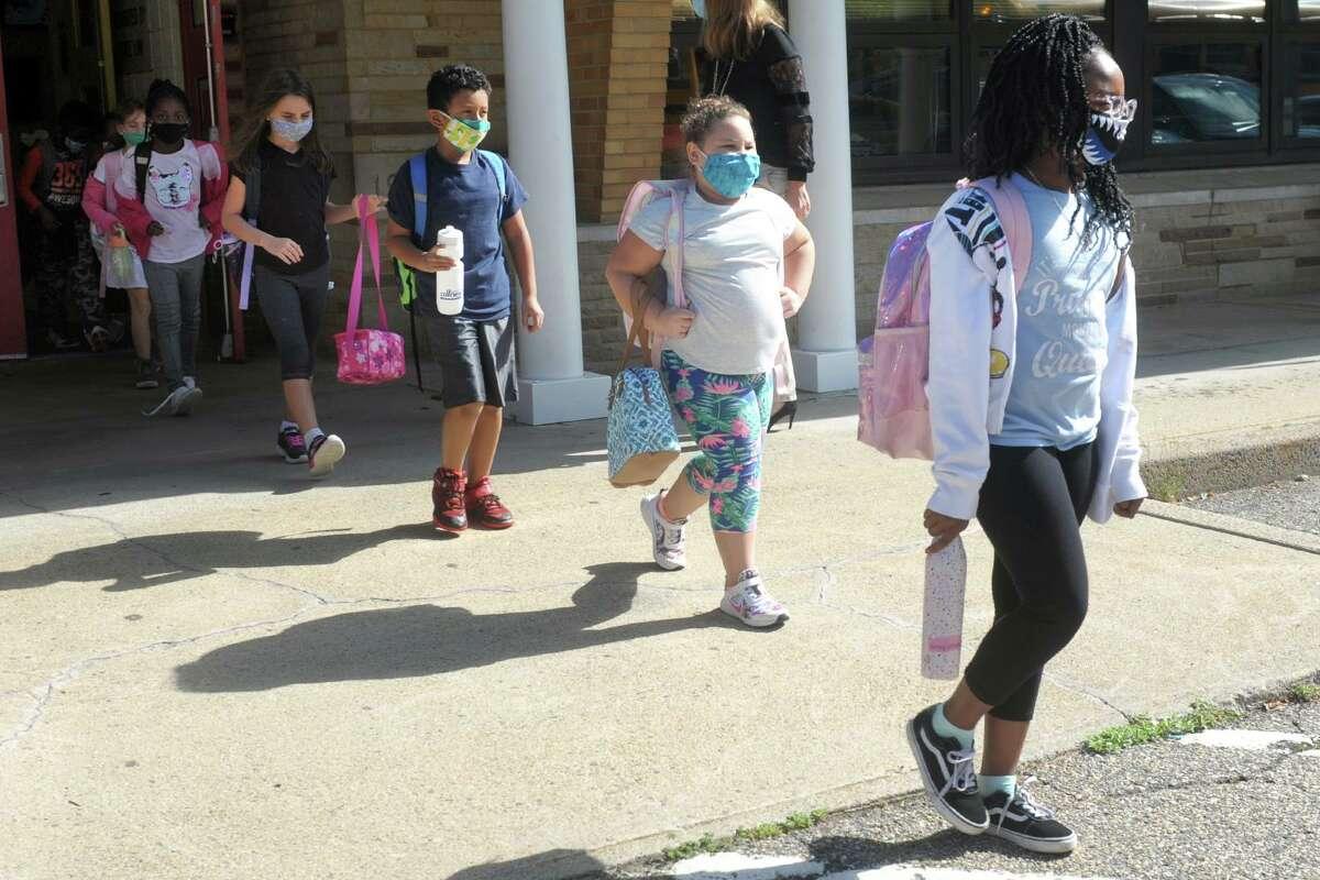 Students leave Sunnyside Elementary School at the end of the school day at Sunnyside Elementary School, in Shelton, Conn. Sept. 30, 2020.
