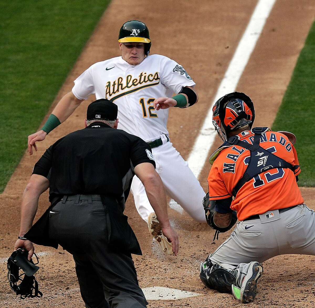Sean Murphy (12) out at the plate in the seventh inning as the Oakland Athletics played the Houston Astros in the first game of a double header at the Coliseum in Oakland, Calif., on Tuesday, September 8, 2020. The A's won the game 4-2.