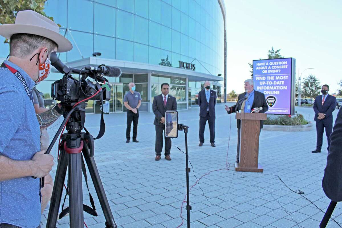 Fort Bend County Election Administrator John Oldham (center at podium) speaks during a Oct. 1 news conference at Smart Financial Center.