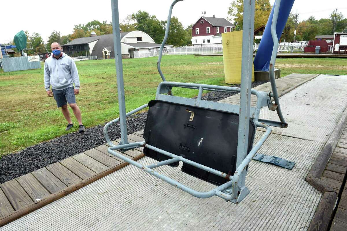 Mount Southington general manager Jay Dougherty is photographed by one of the chair lifts at the ski area in Southington on Oct. 2, 2020. One of the preparations being made for the upcoming ski season is to separate the lines approaching the chairlifts by six feet.