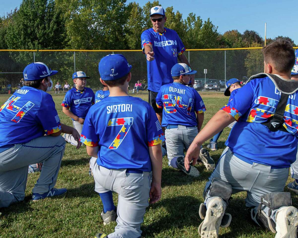 North Colonie Bison 11U coach Sean Gavin talks to his team prior to a game against Guilderland at the Boght Road Baseball complex in Colonie, NY, on Saturday, Sept. 26, 2020. The coaches and players were all sporting jerseys with colored puzzle pieces, the symbol for autism, fashioning their numbers adn trim (Jim Franco/special to the Times Union.)